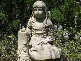 A statue from the gravemarker of a young girl.