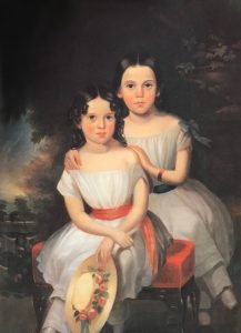 A painted portrait of two young girls wearing white dresses sitting against a dark, arboreal background.
